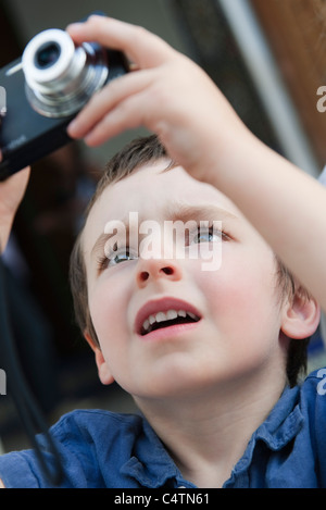 Little boy using digital camera - Stock Photo
