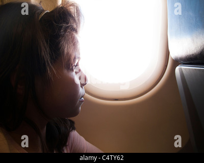 Girl ,9 years old,on an airplane - Stock Photo