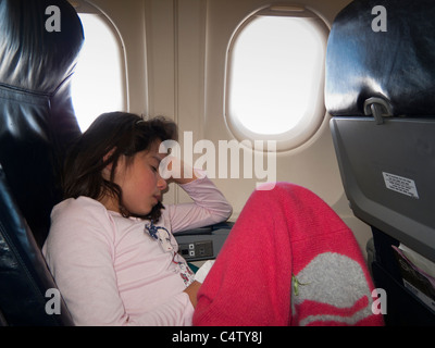 Girl Sleeping On Airplane Stock Photo Royalty Free Image