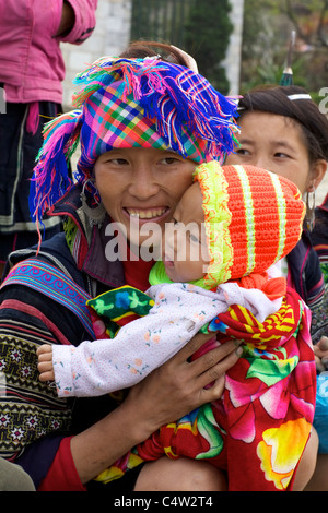 Black Hmong Ethnic Minority Girl and Baby in Vietnam - Stock Photo