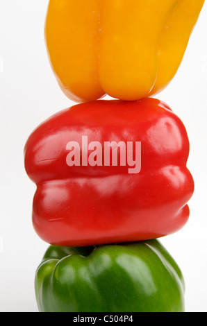 Three stacked  sweet peppers. - Stock Photo