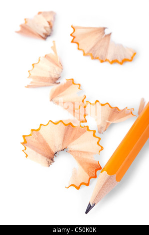 Pencil and shavings over white background - Stock Photo