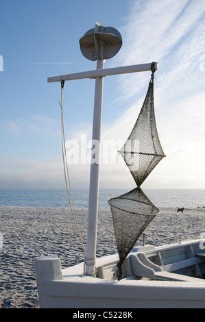 Boat with a fishing net on a beach in winter, Sierksdorf, Luebeck Bay, Baltic Sea, Schleswig-Holstein, Germany, - Stock Photo