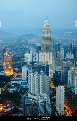 Petronas Twin Towers illuminated at night, Kuala Lumpur, Malaysia, Southeast Asia, Asia - Stock Photo