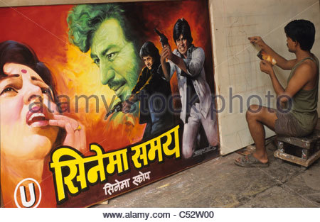 INDIA Mumbai, painting of Bollywood movie posters for cinema at Balkrishan Arts a film hoarder in Dadar - Stock Photo