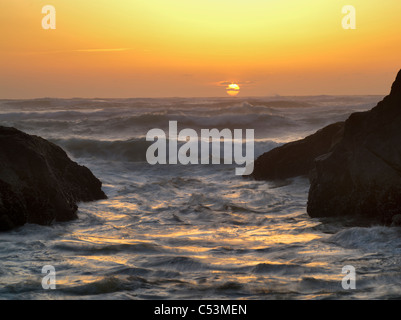 Sunset in cove. Smelt Sands State Park, Oregon - Stock Photo