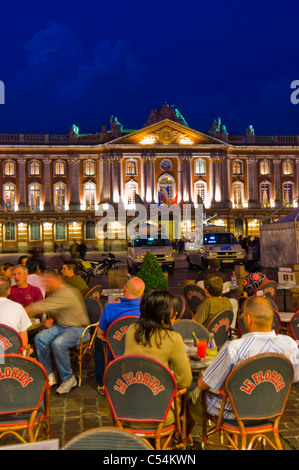 Toulouse, France,The Capitole of Toulouse, and the square of the same name, lit up at Night, Crowded Café Terrace - Stock Photo