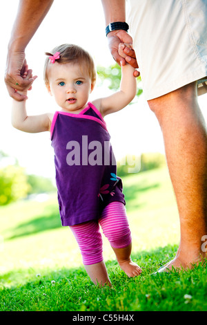 Man helping her daughter to walk, Traverse City, Grand Traverse County, Michigan, USA - Stockfoto