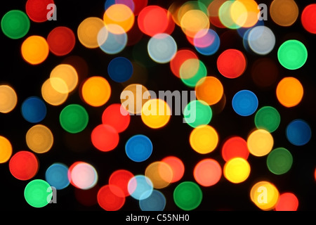Spots of different colors red blue green yellow orange on a black background - Stock Photo