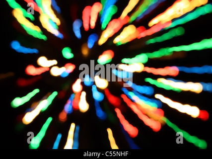 Bands of different colors red blue green yellow orange on a black background - Stock Photo