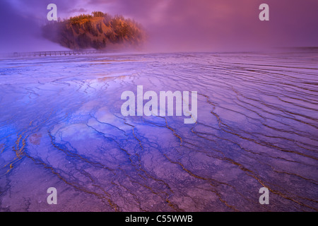 Steam erupting from a hot spring, Grand Prismatic Spring, Midway Geyser Basin, Yellowstone National Park, Wyoming, - Stock Photo