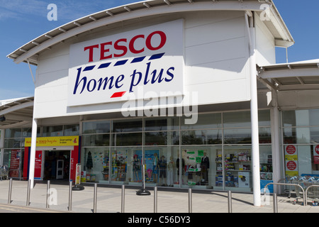 tesco home plus entrance to store and company logo sign at. Black Bedroom Furniture Sets. Home Design Ideas