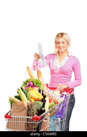 A smiling woman checking her shopping receipt - Stock Photo