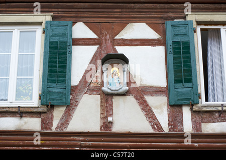 Detail of a house with fachwerk and a christian mural in the city of Haslach, Schwarzwald, Baden-Wurttemberg, Germany - Stock Photo