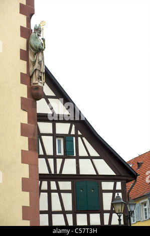 Detail of an old house and a church with fachwerk in the city of Haslach, Schwarzwald, Baden-Wurttemberg, Germany - Stock Photo