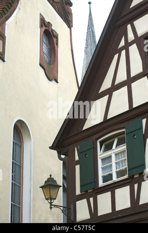Detail of an old house and a church with half-timbering in the city of Haslach, Schwarzwald, Baden-Wurttemberg, - Stock Photo