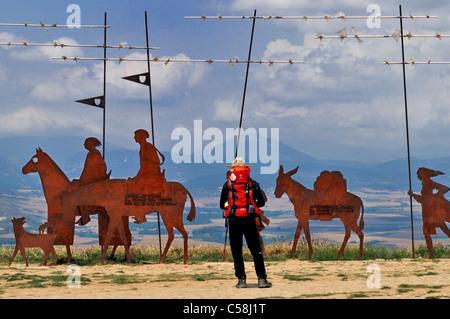 Spain, St. James Way: Pilgrim at the Monumento del Peregrino in Alto del Perdon - Stock Photo
