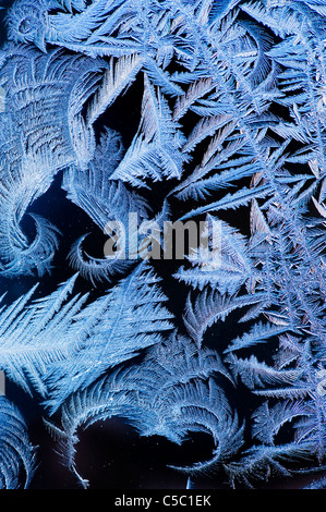 Close-up of ice crystals against black background - Stock Photo