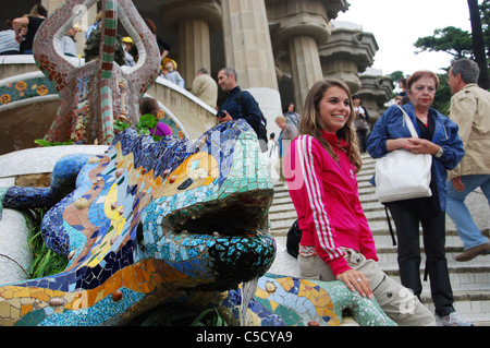 posing near the famous lizard in Parc Guell Barcelona Spain - Stock Photo