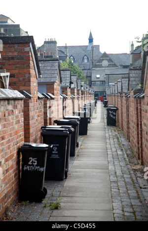 Back alley with rubbish bins. The Railway Village built by GWR to house workers in the 1840s, Swindon, England - Stock Photo