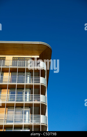 Cropped high section of a building apartment against clear blue sky - Stock Photo