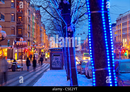 View of a decorated street along buildings during Christmas - Stock Photo