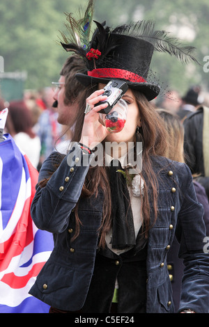 THE ROYAL WEDDING DAY 20011,young female reveller enjoys a quick drink whilst enjoying the happy atmosphere in Hyde - Stock Photo