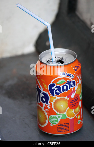 a soda can with reed standing on a windowsill - Stock Photo