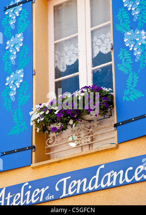 Beautifully decorated blue shutters and window display, Fayence, Provence, France - Stock Photo