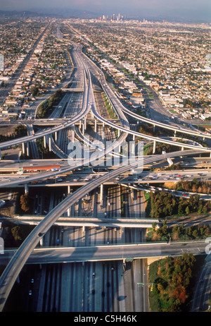 Aerial view of Los Angeles freeways like twisted cemented spaghetti amid urban sprawl and downtown Civic Center - Stock Photo