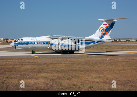 Commercial air freight transport. Volga-Dnepr Airlines Ilyushin Il-76TD heavy cargo jet taxiing for departure from - Stock Photo