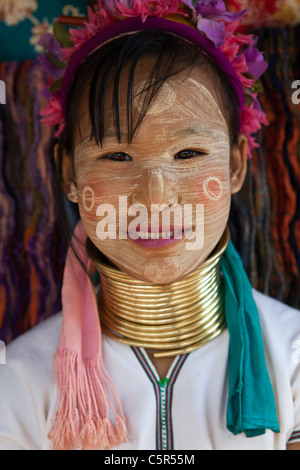 """Padaung of the Karen hill tribe are also known as """"long-necks"""" because of the heavy brass rings they wear around - Stock Photo"""