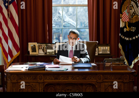 President Barack Obama reviews his prepared remarks on Egypt at the Resolute Desk in the Oval Office, Feb. 11, 2011. - Stock Photo