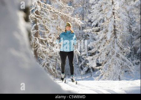 Austria, Tyrol, Seefeld, Woman cross country skiing - Stock Photo