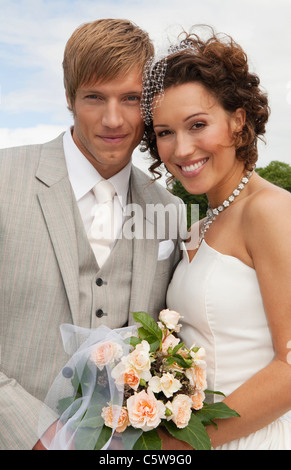 Germany, Bavaria, Portrait of groom and bride, outdoors, close-up - Stock Photo