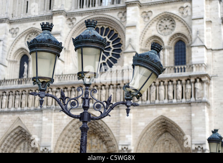 Bent street light, lampadaires, one of three, outside the Notre Dame Cathedral in Paris, France - Stock Photo