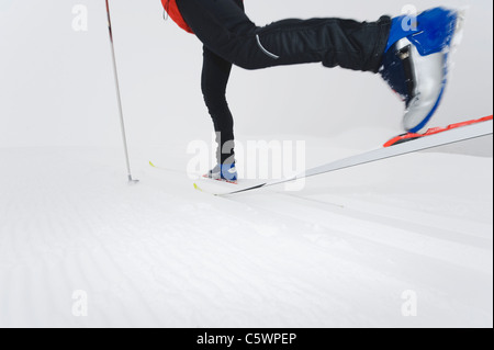 Italy, South Tyrol, Person cross-country skiing, low section - Stock Photo