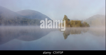 Loch an Eilein on misty morning, Rothiemurchus Forest, Cairngorms National Park, Scotland, Great Britain. - Stock Photo