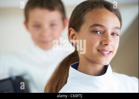 Girl wearing fencing costume - Stockfoto