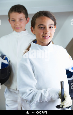 Children wearing fencing costumes - Stock Photo