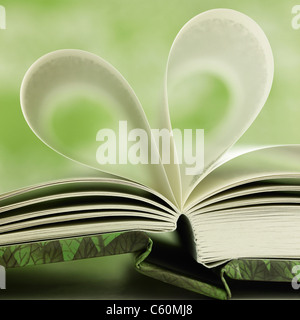 Close up of book pages forming heart - Stock Photo