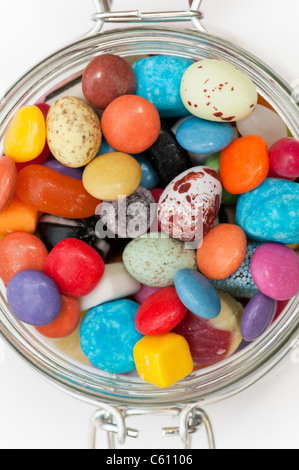 Colourful assorted childrens sweets and candy in a jar - Stock Photo