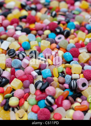 Colourful assorted childrens sweets and candy. Liquorice allsorts, Smarties, pineapple cubes, humbugs, bonbons, - Stock Photo