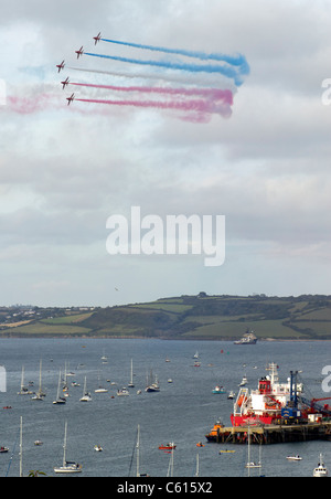 The Red Arrows Royal Air force aerobatic team flying over Falmouth in Cornwall UK. - Stock Photo