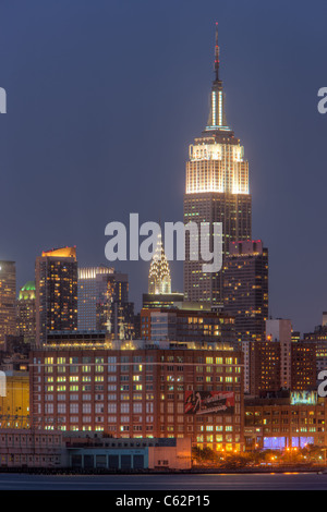 The Empire State Building, Chrysler Building, and other Manhattan skyscrapers at twilight in New York City. - Stock Photo