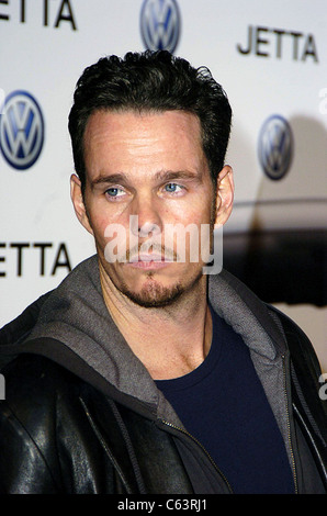 Actor Kevin Dillon poses for photographers, at the launch of the 2005 Volkswagen Jetta at The Lot, Los Angeles, - Stock Photo