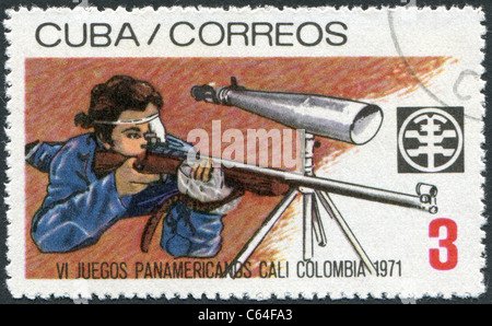 CUBA - 1971: A stamp printed in Cuba, is dedicated to Pan American Games in Colombia, shows the bullet shooting - Stock Photo