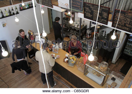 Lower Manhattan New York City NYC NY SoHo Broome Street Milux Cafe restaurant cafe casual dining Black woman man - Stock Photo