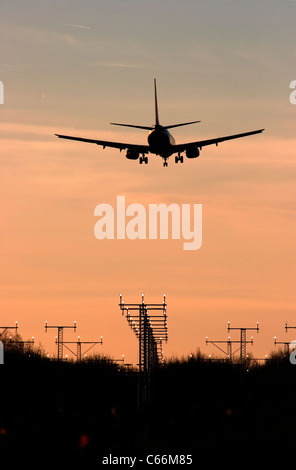 Plane passing navigation beacons on the approach to London Luton airport - Stock Photo