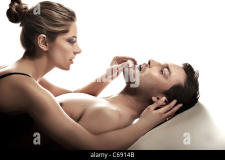 Sensual photo of happy couple - Stock Photo